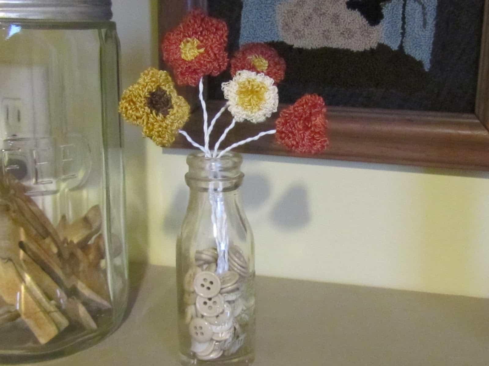 finished jar of punch needle flowers