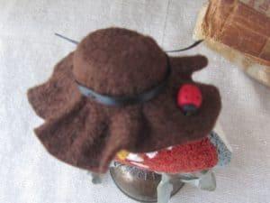 Felt hat with ladybug
