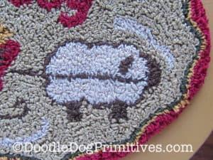 Close-up of punch needle sheep