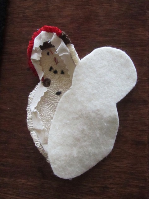 Snowman and wool backing