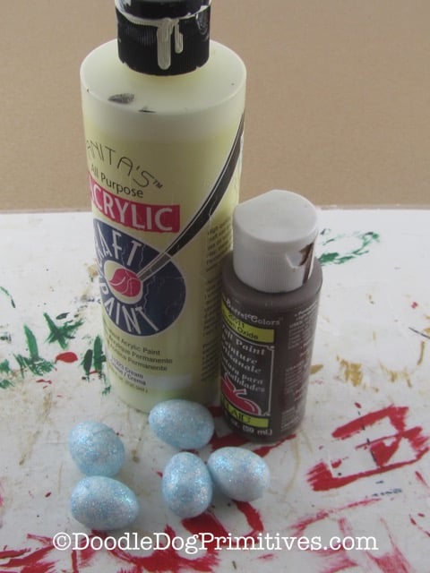 Paints and eggs needed for this craft