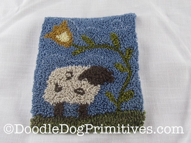 Finished front of the primitive sheep punch needle pattern