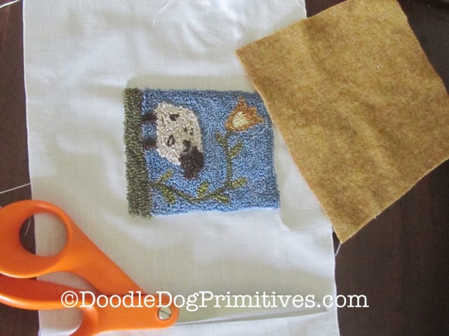 Wool, punch needle project, scissors