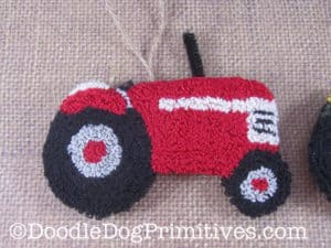 Red Punch Needle Tractor