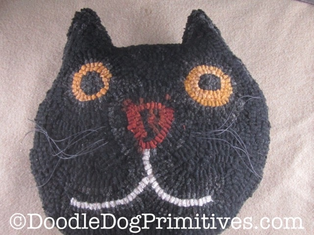 black cat hooked pillow