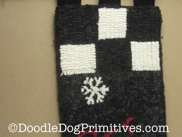 Hooked rug black and white checks