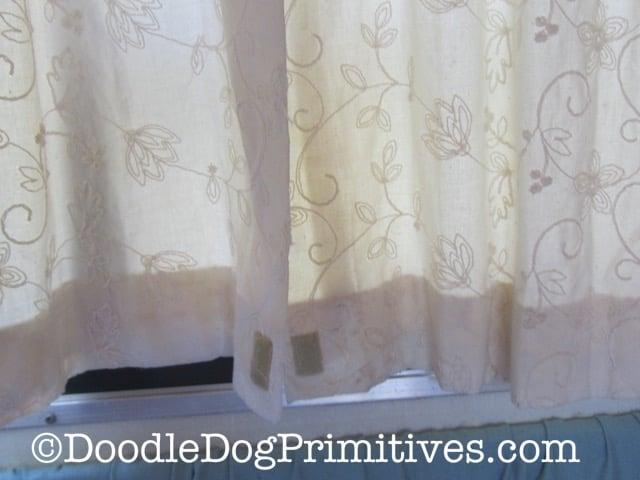 Hung vintage camper curtains