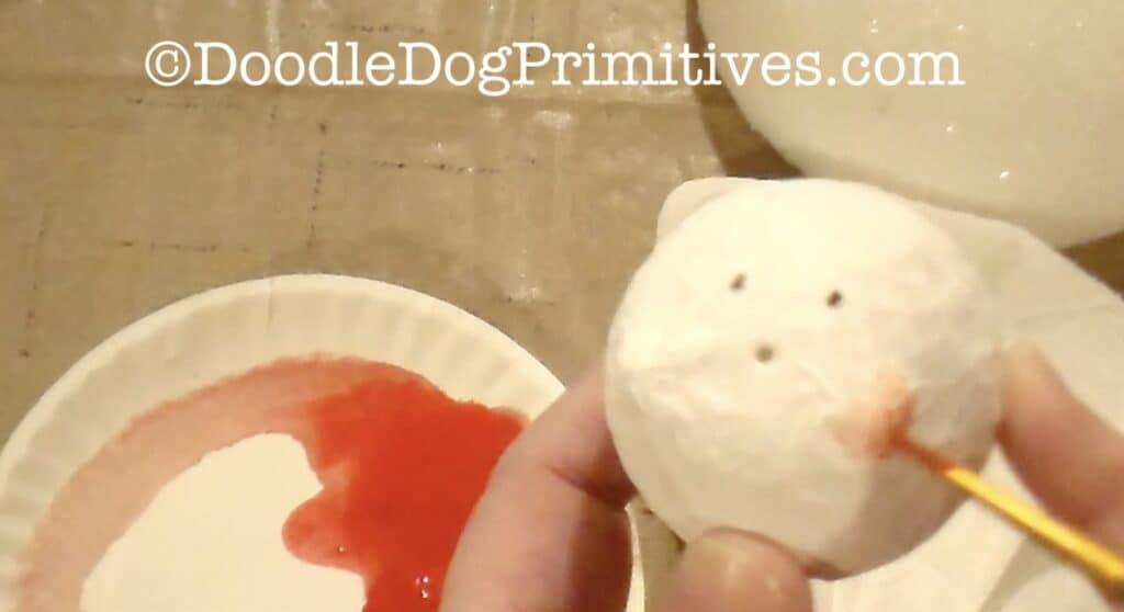 paint snowman cheeks