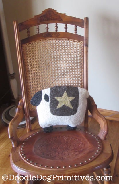 sheep pillow in rocking chair