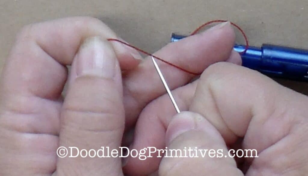 poke needle through pearl cotton