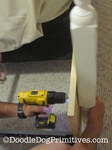 Attaching the full-size footboard to the queen size frame
