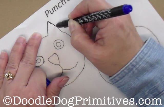 Trace the punch needle pattern using the iron on transfer pen