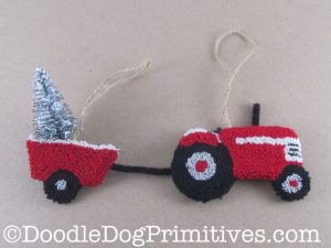 Tractor pulling a Christmas tree wagon