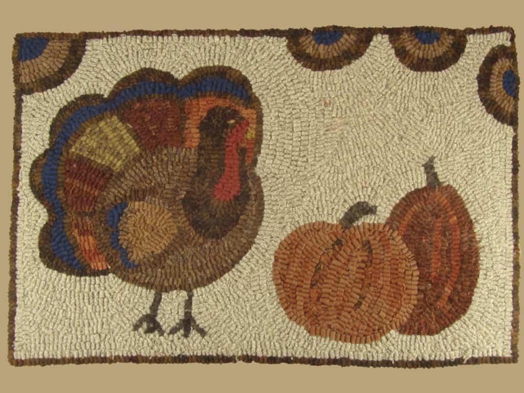 Primitive pumpkin hooked rug