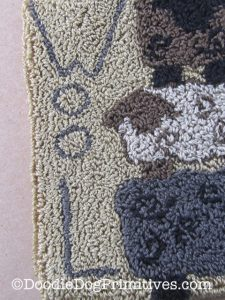 Letters WOOL on punch needle project